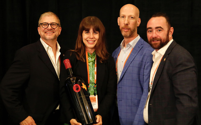 Master Sommeliers Jay James (L), James Tidwell and Drew Hendricks (R) with winner Christina Walther at TexSom.