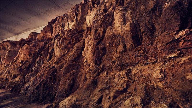 A rock wall bisects Vina Eden's cellar.